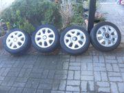Biete gebrauchte Reifen auf Sportfelgen
