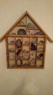 Holzhaus mit Achatscheiben
