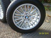 Neuwertiger Winterreifenradsatz mit BMW-Felgen für