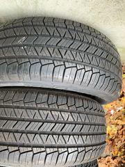 4x neuwertig Allwetter Reifen 235