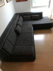 Sofa schwarzbraun Stoff/