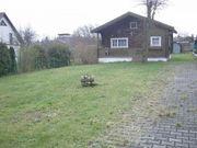 Grundstück mit Holzwohnhaus